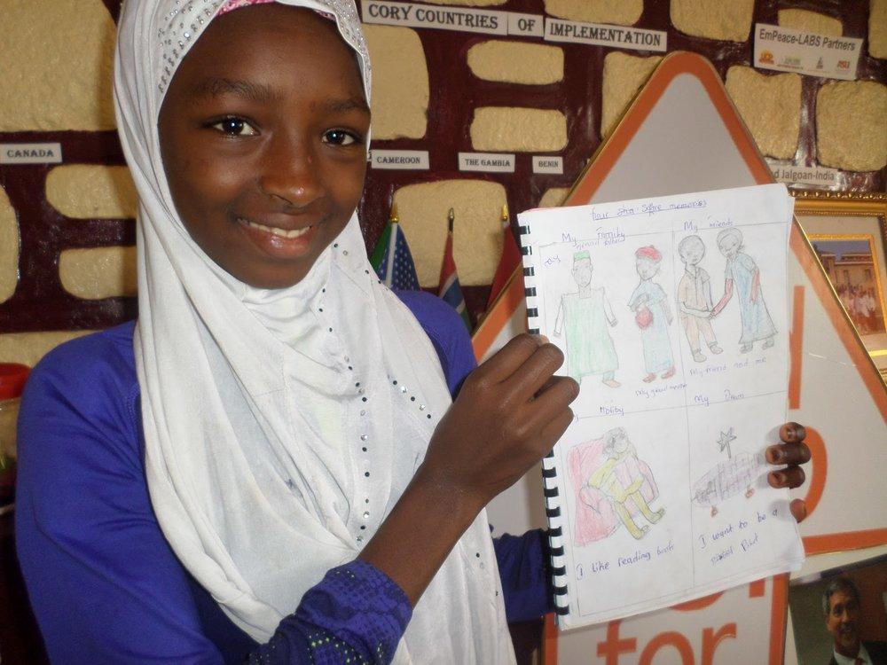Fatimatou presenting her Four Square Memory.