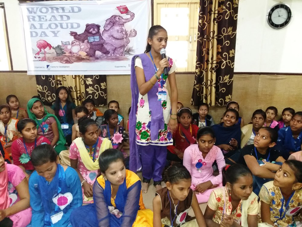 A LitKid at Center for Development in Ahmedabad, Gujarat, India, shares a story aloud   with her peers on World Read Aloud Day.