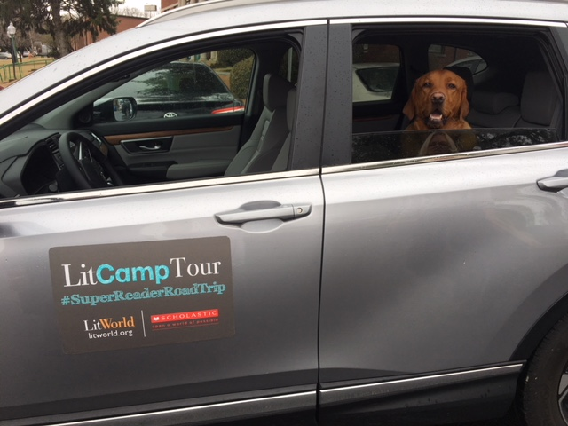 Dewey hitches a ride in the back seat of the LitCamp Tour-mobile!