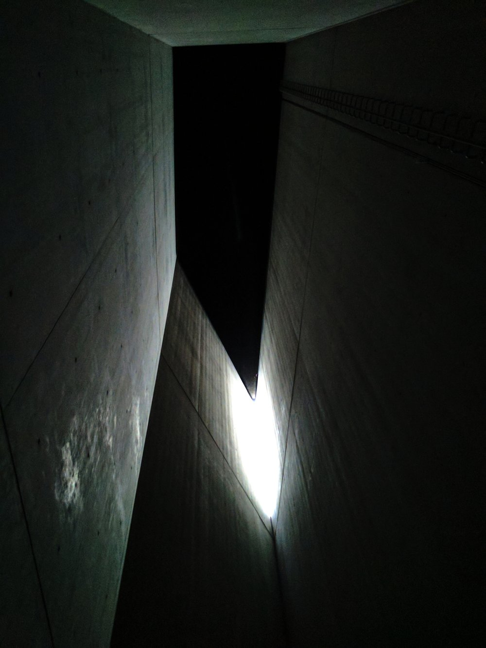 The only source of light inside the tower, blatantly out of reach for those inside.