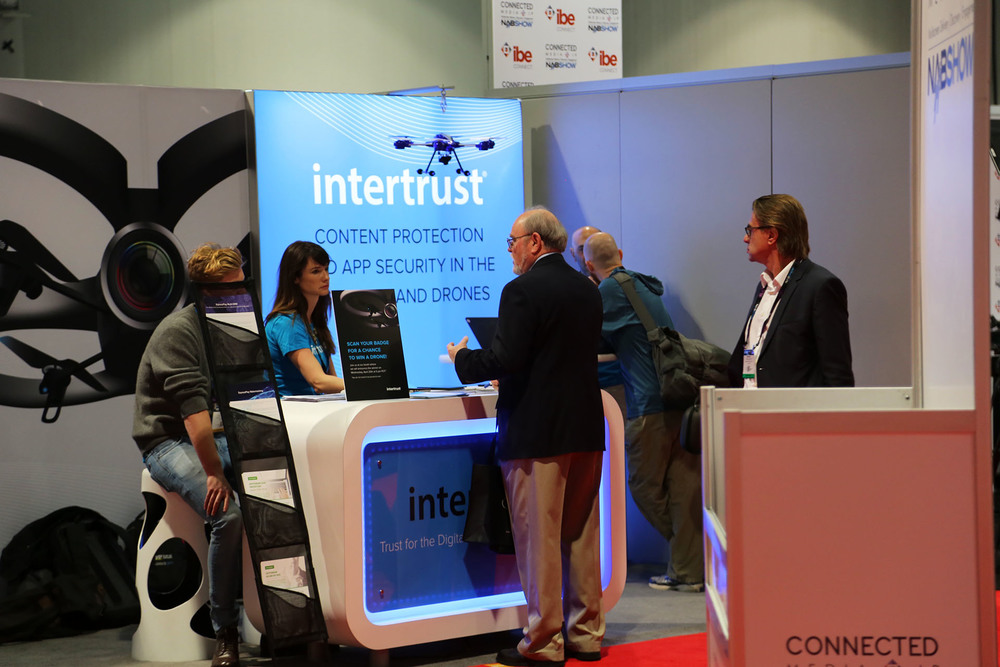 Intertrust employees inform visitors about the company's digital entertainment ecosystem solutions.