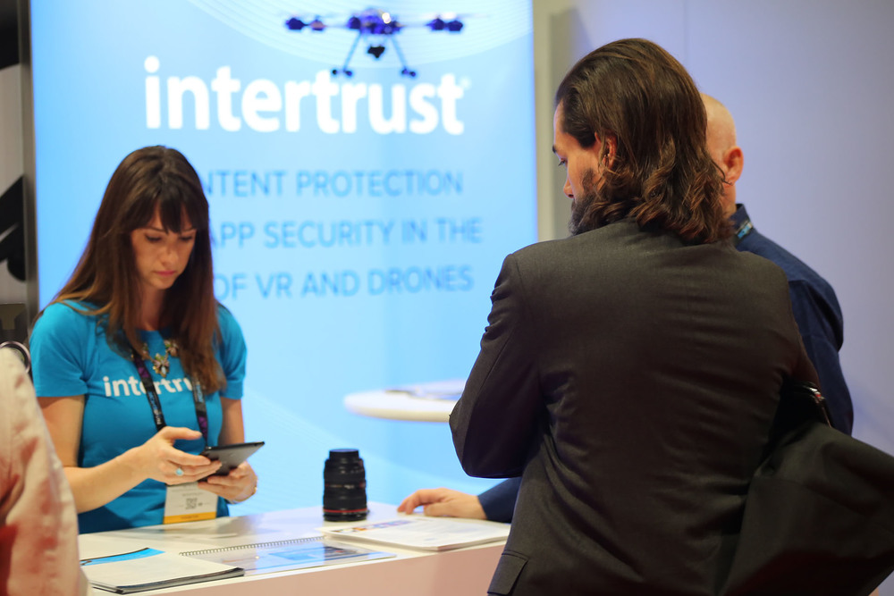 Intertrust Personagraph Product Evangelist Beth Kindig enters an exhibit visitor by scanning his badge.
