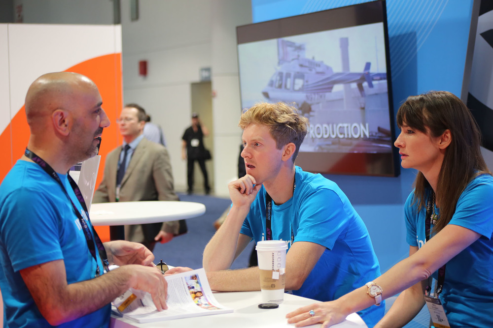 Our team discusses customer feedback at the booth and how to improve our products.