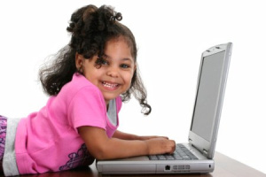 What do you think weighs more, the kid or the laptop?