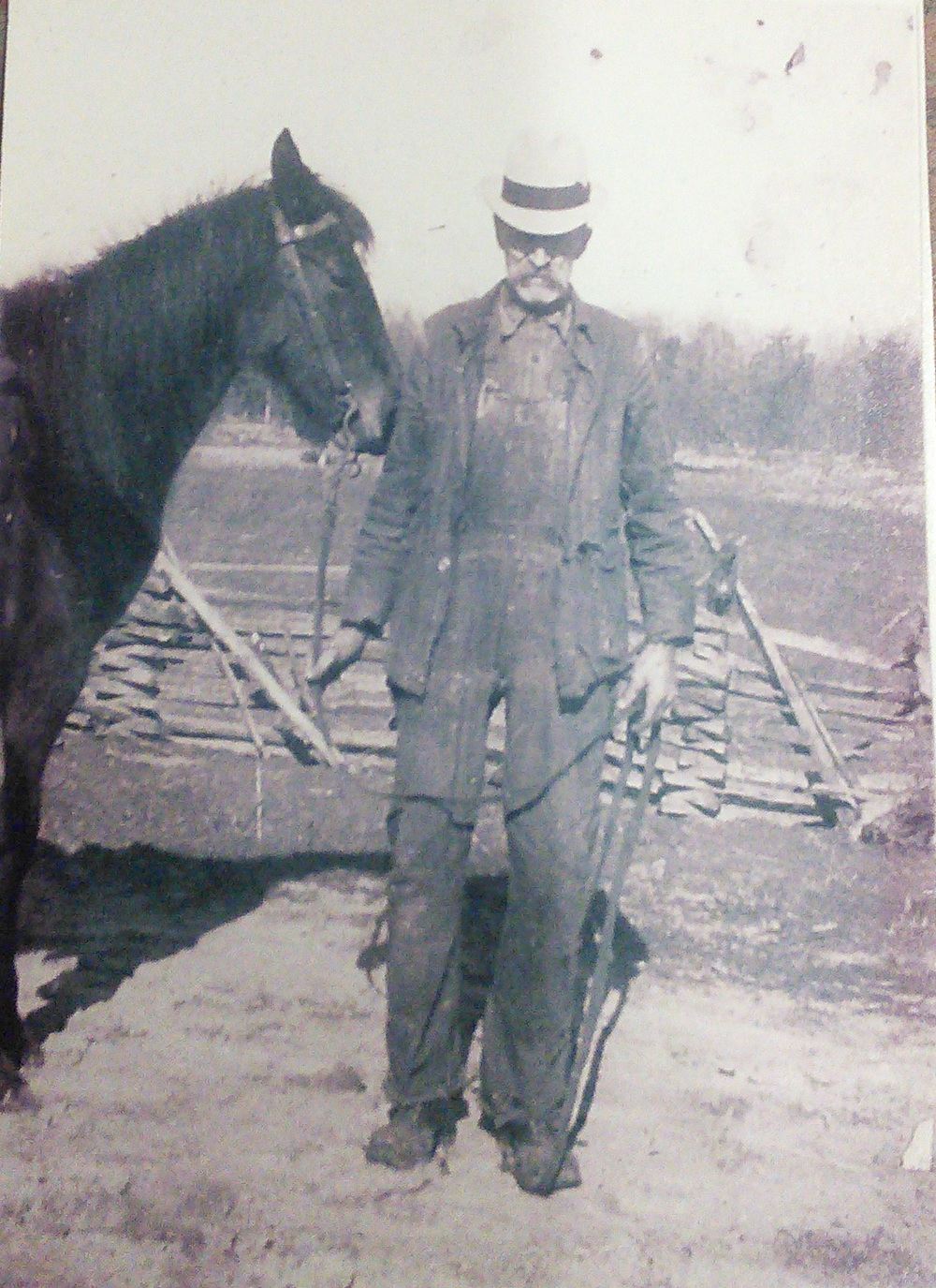 Early 1930's Mountian Farmer - you can see the farm in the background with the split rail fence.  He's proud enough of his horse that he's posed for a picture with it.