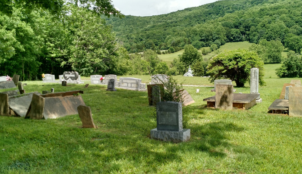 Highland Cemetery in Dry Hollow, Tennessee.  Can you see the steeple of the little church peeking up beyond the hill?