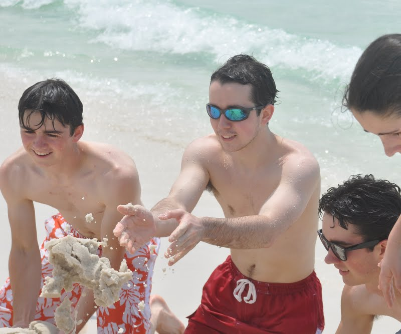 Boys Building a Sand Castle