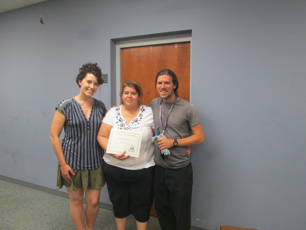 Blanca Perez (middle) with Inter-Faith Food Shuttle Katie Murray (L) and Alliance Community Garden & Wellness Coordinator Jesse Crouch (R) at Seed to Supper Graduation.