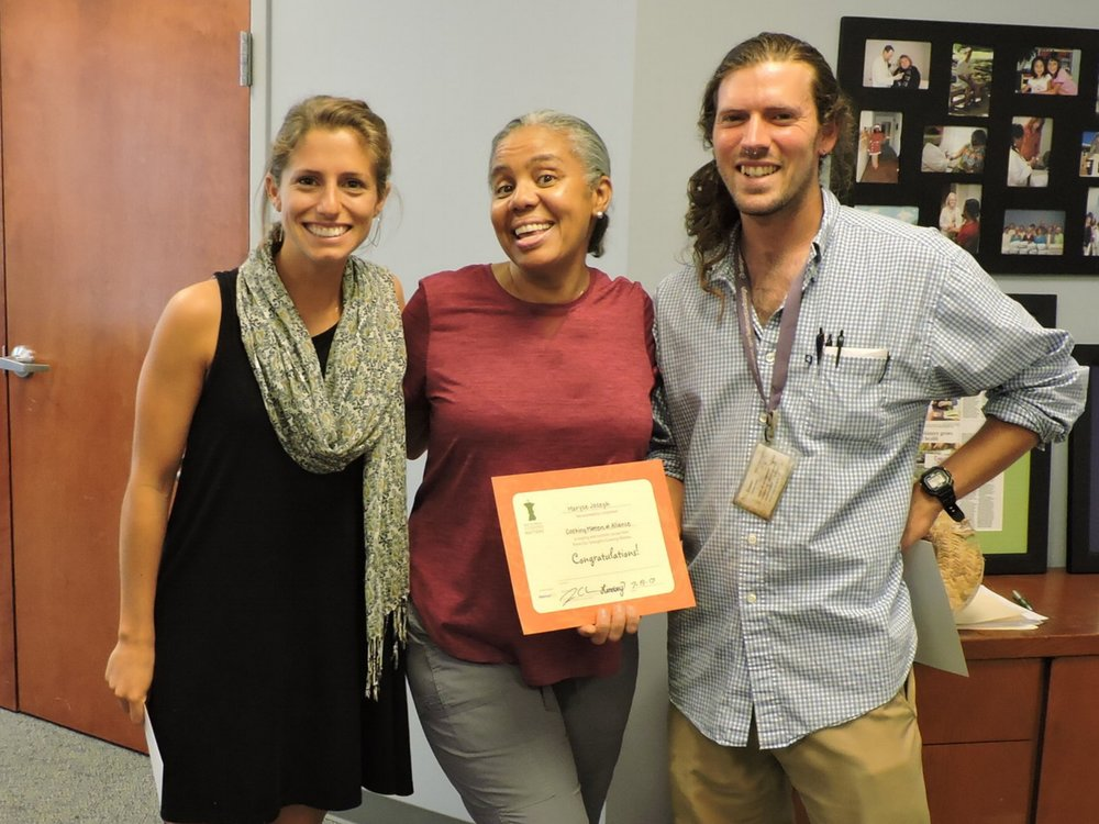 L to R:  Volunteer Cooking Matters instructor Lindsey Miller, Alliance patient Maryse Joseph, and Garden and Wellness Coordinator Jesse Crouch at Cooking Matters graduation.