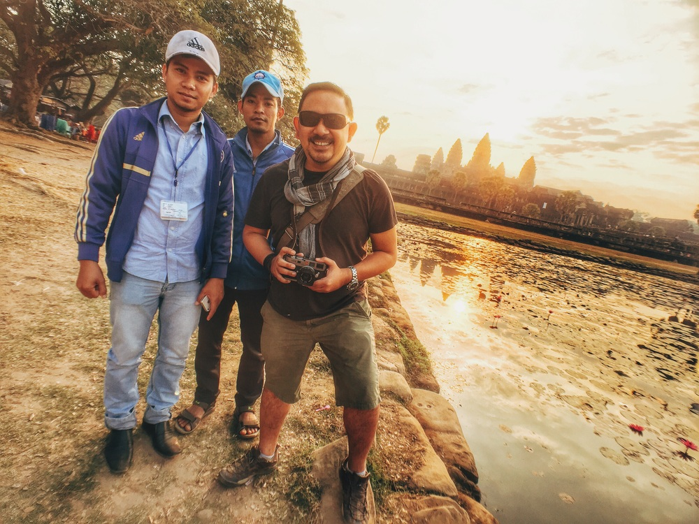 With our guides from Apsara, responsible for our filming permits and annoyance control. When you want to block busloads of tourists, they can come in handy.