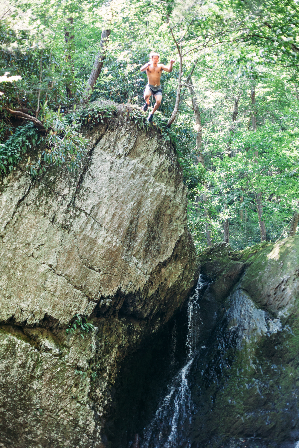 Cliff jumping off a waterfall along Adams Creek Trail in the forests of Pennsylvania.