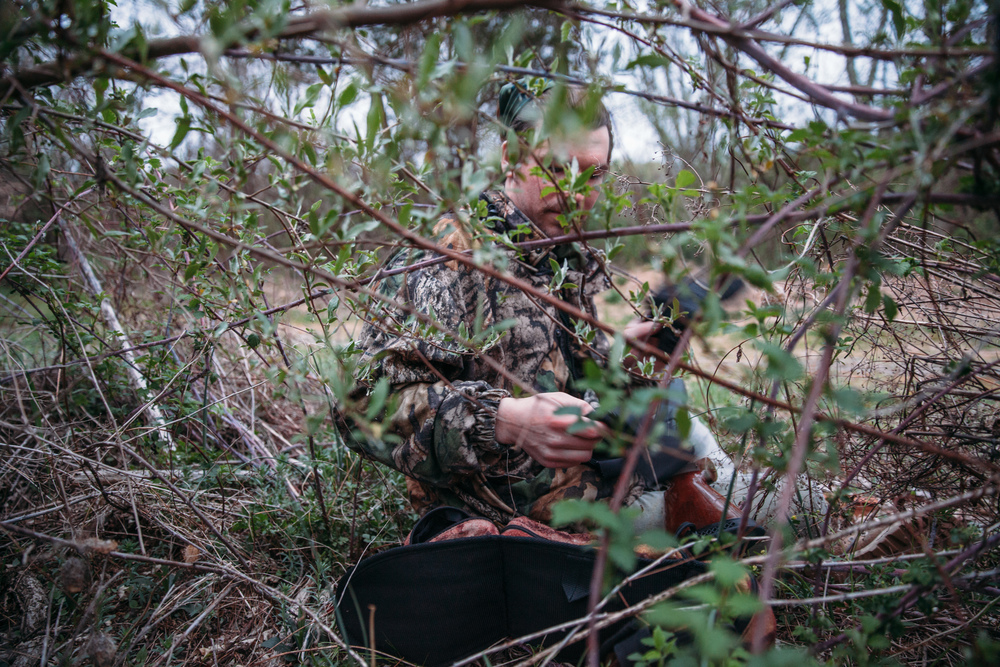 Hiding in brush with our camouflage to hide during turkey hunting in the Delaware Water Gap.
