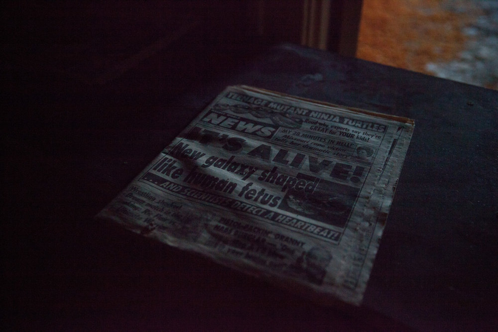 A tabloid newspaper left from the 1990's, when the historic Buck Hill Inn closed down.
