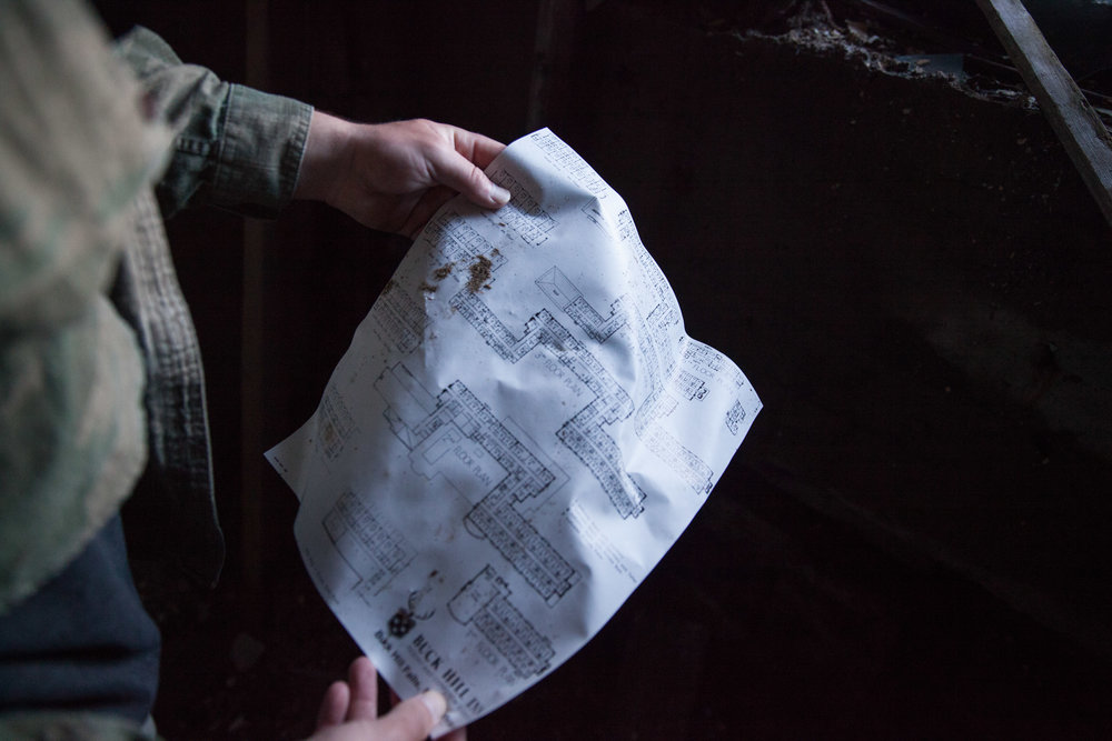We found a floor plan from 1985, helping with navigation through the dimly lit estate.