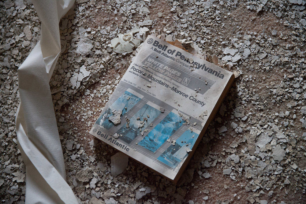 An old telephone book left at the abandoned and decaying Buck Hill Inn resort destination in the Poconos.