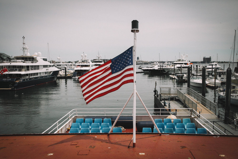 On the Boston Harbor Islands ferry, an american flag waves in the air.