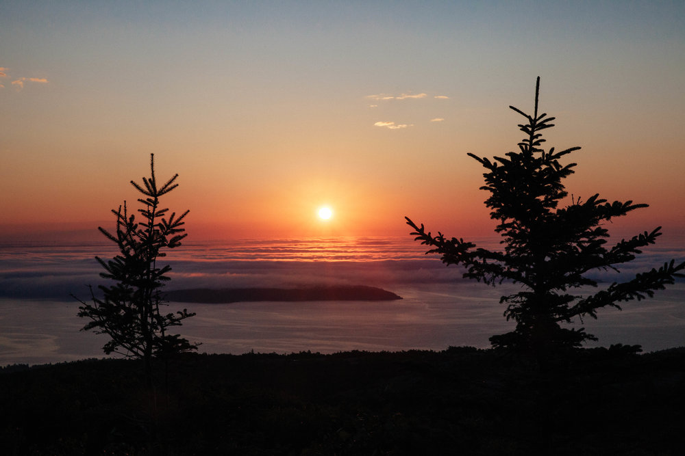 An iconic Cadillac Mountain sunrise in Acadia National Park in Mount Desert, Maine.