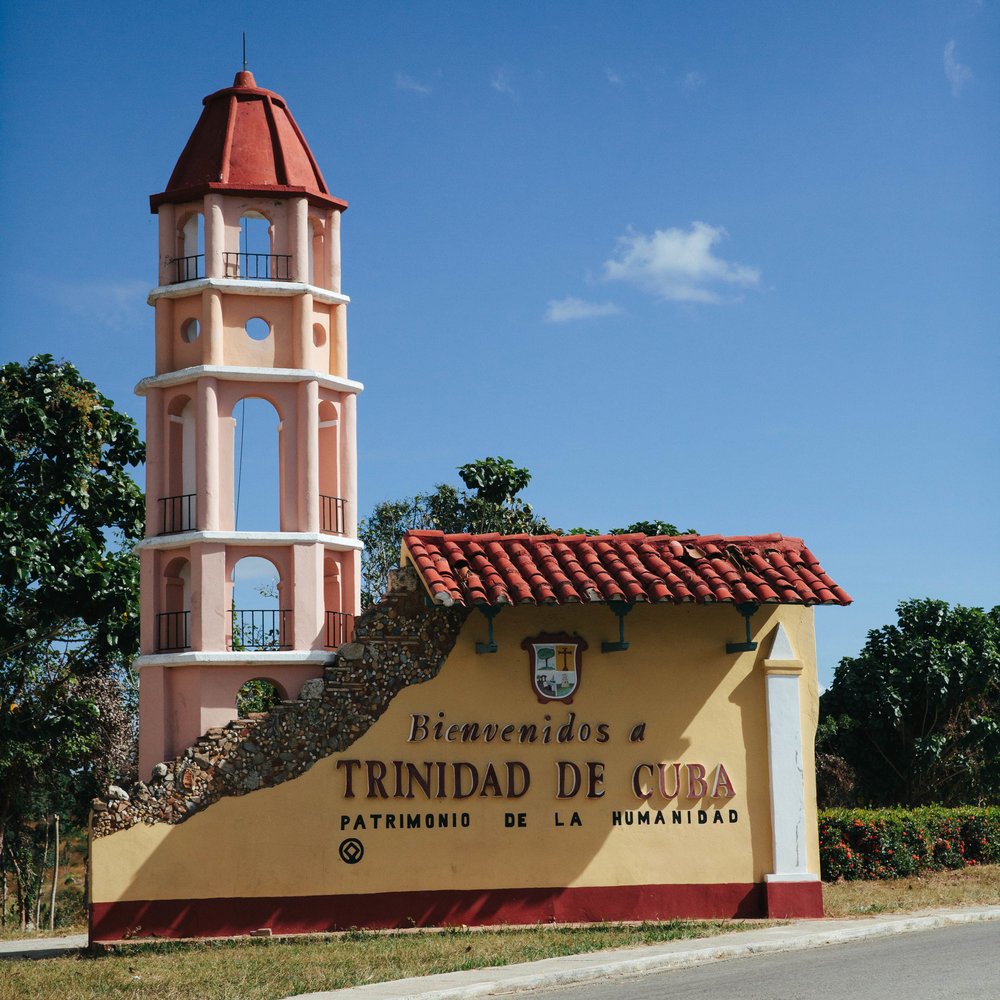 The UNESCO World Heritage city of Trinidad in Cuba and the sign of the city's entrance.