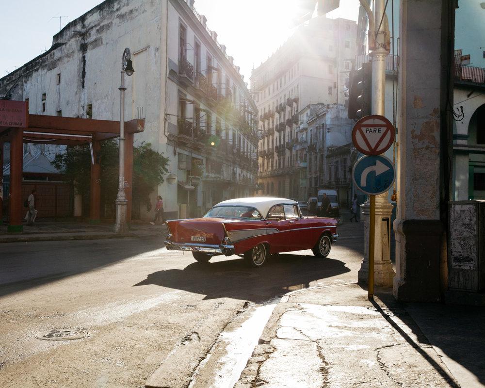 Restored shiny red 1950's classic car in Havana, Cuba, near Chinatown.
