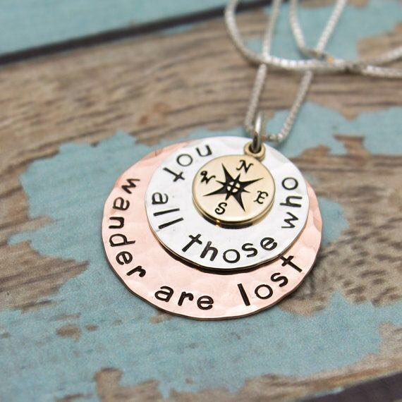 Today I'm celebrating #loveyourshopsweeps and sharing a design from my mom's etsy shop @tracytayandesigns. She (along with me + Grammy) creates unique hand stamped jewelry that make great gifts for celebrating every milestone. From necklaces for your Mom-mom and keychains for pop-pop, to graduations to engagements to cufflinks to bookmarks, she makes your #futureheirloom so you can celebrate for years to come. ⠀ This is one of my favorite designs as it is one of my favorite quotes. I also have a thing for compasses. Anyway, check out her shop, you'll find some awesome stuff ⠀ .⠀ .⠀ .⠀ .⠀ .⠀ #tracytayandesigns #etsyshop #etsyfinds #etsylove #etsysellersofinstagram #compassjewelry #notallthosewhowanderarelost #lordoftherings #lotrjewelry #compassnecklace #compass #graduationgift #giftgiving #handmadejewelry #giftforher #giftidea #jewelrygifts #wanderlust #travelbug #birthdaygift #handstampedjewelry #mixedmetals #traveljewelry #neverstopexploring #wanderlustjewelry #personalizedjewelry ⠀