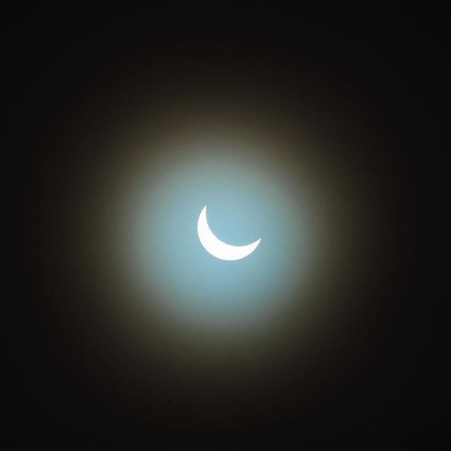 """Remember to look up at the stars, not down at your feet.  Try to make sense of what you see & wonder about what makes the universe exist.  Be curious."" — Stephen Hawking ___________________ Still one of the most awesome things we've seen was the 2017 Solar Eclipse close to the line of totality in Pacific City, Oregon. #happyastronomyday"
