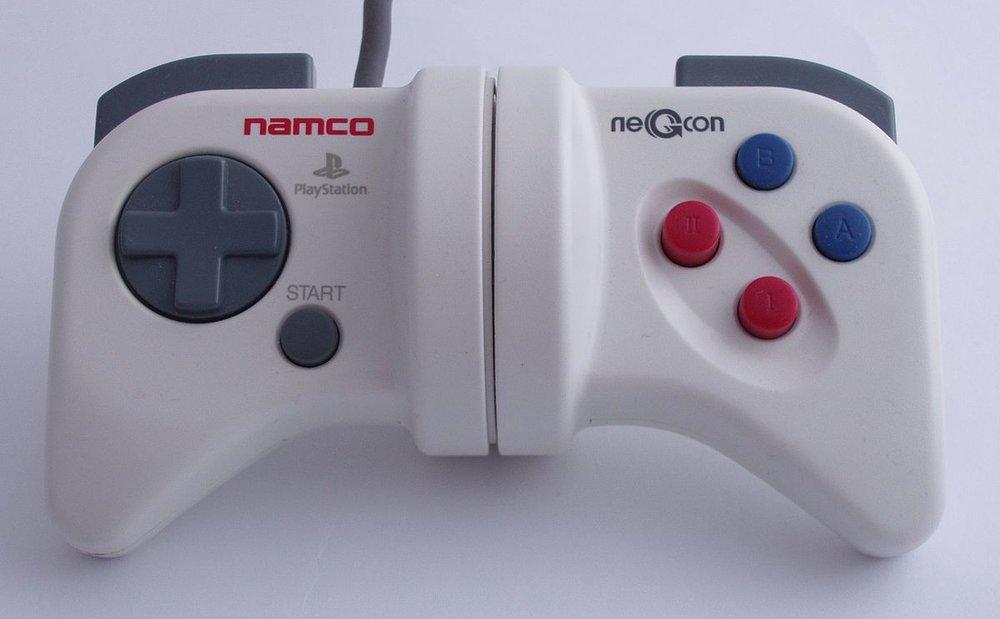 1200px-Namco_Negcon_centred.jpg