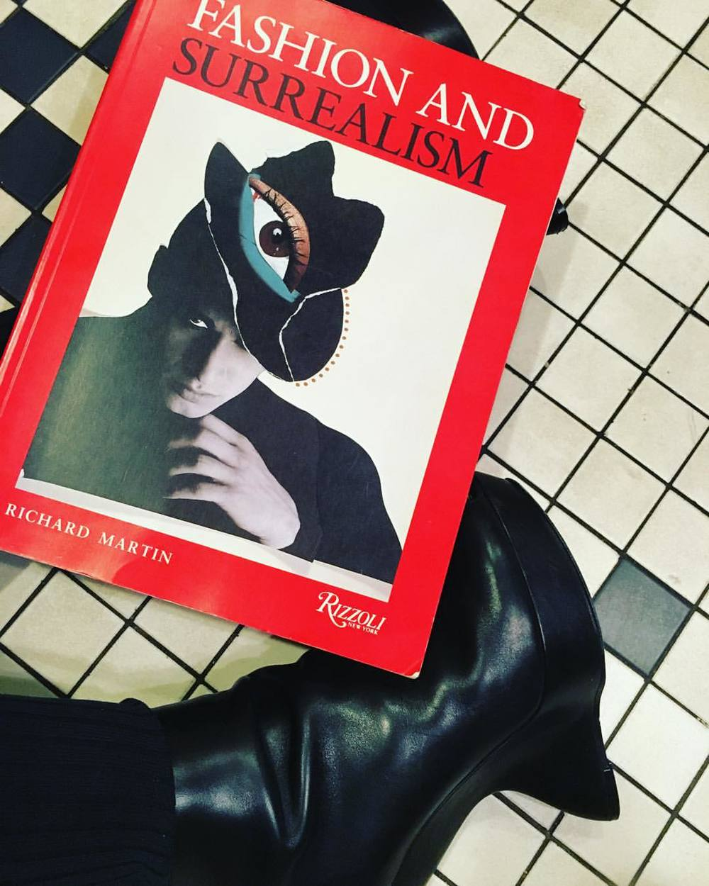 Sometimes new books and boot are the best medicine. Both second hand and bought when a pinched nerve made it impossible to move. #alexandermcqueen #heelless booties and #fashionandsurrealism book from #rizzolibooks.