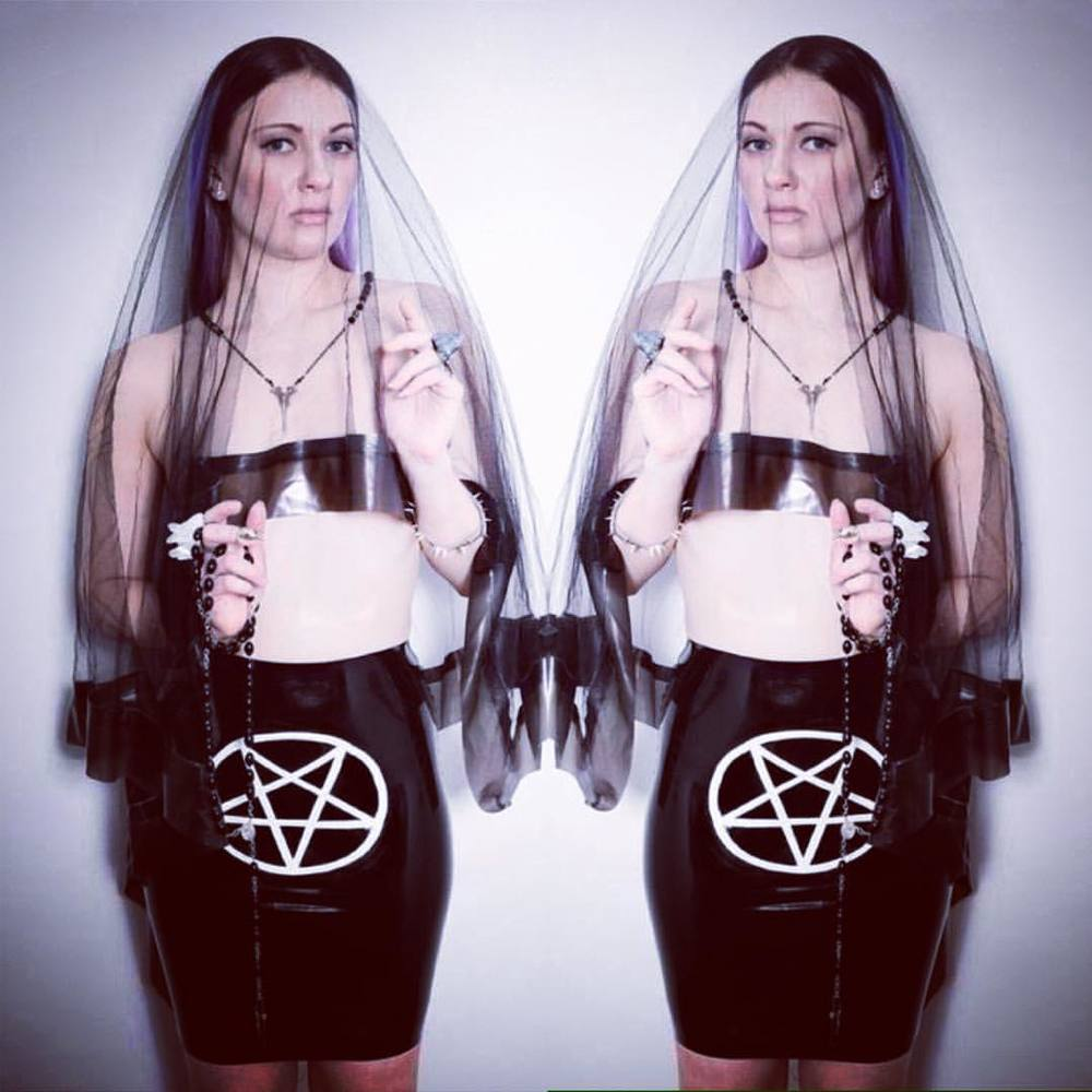 We are too busy working in the #babyloveslatex studio this week so please enjoy @lenamarquise in our #pentagram #latexskirt available on #reneemasoomian.com and #latex trimmed #veil available upon request. #fashionlatex #bespokelatex #spookyfashion #occultfashion #customlatex #couturelatex #fetishwear #fetishfashion #latexfashion #darkfashion #darkstyle #halloweenstyle