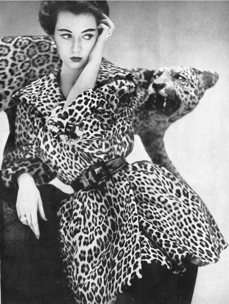 dovima-down :     Dovima wearing a Leopard fur coat by Bernham-Stein,by   Richard Avedon, (1950)