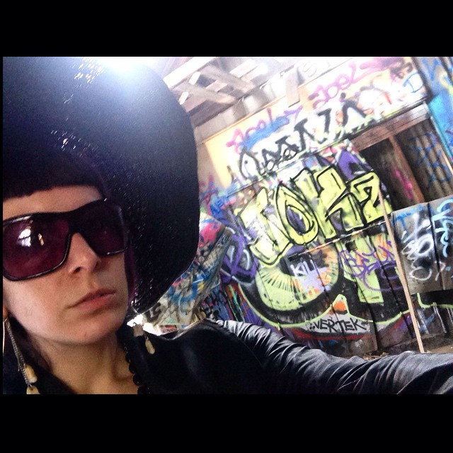 From earlier today at the #oldzoo in #griffithpark, LA. #sunhat, #alexandermcqueen sunglasses, #teethearrings. #graffiti #graffitiart #oldzoogriffithpark #colorful #streetstyle #hikingadventures