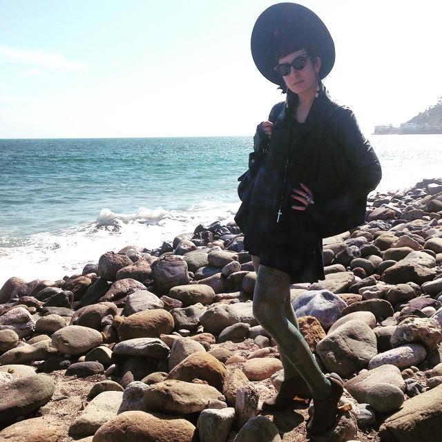Just doing some rock beach climbing in my heels in Malibu. #vintagehat, #leatherjacket, #viviennewestwood tights, #unitednude heels, and #thierrymugler #vintagesunglasses. #darkstyle #darkfashion #dark #beachstyle #style #fashion #vintagemugler