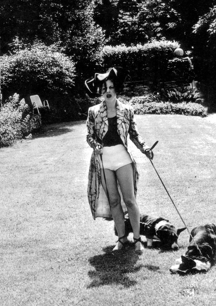 fuckyeahenglisheccentrics :     Isabella Blow taking the dogs for a walk in the garden