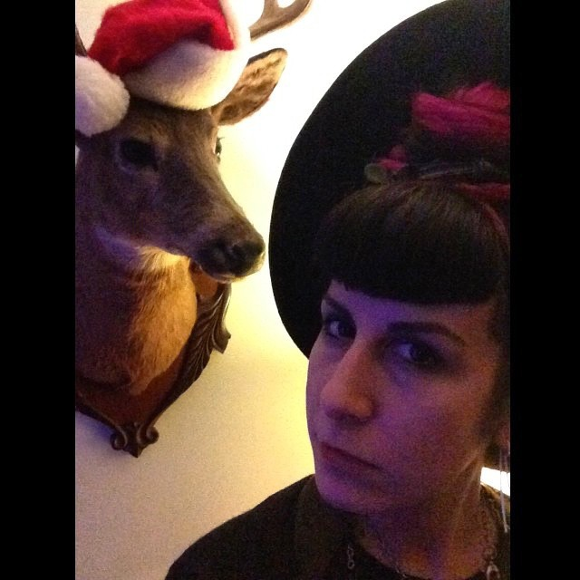 Haven't taken one this year but here is last years holiday photo. #merrychristmas #deaddeer #santahat