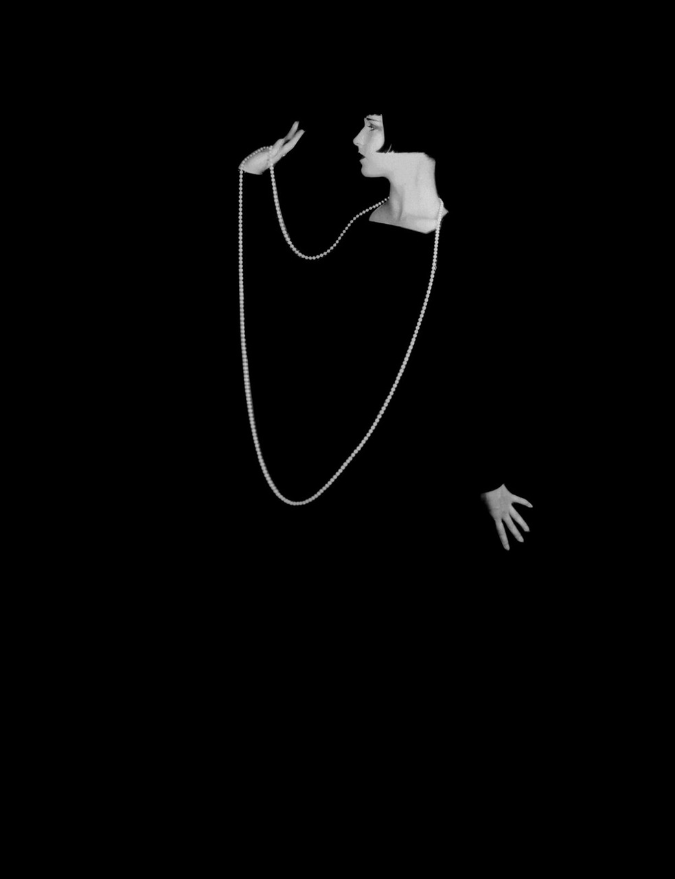 semioticapocalypse: Eugene Robert Richee. American actress Louise Brooks wearing a long necklace that stands out against a black background, 1928 [::SemAp FB || SemAp G+::]