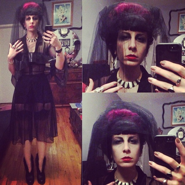 Somehow I ended up looking quite morose tonight. Oh well I guess that's ok I have too much running around to be gloomy. #reneemasoomian vail, #betseyjohnson overdress, #alexandermcqueen skull rings and bracelet, #prada bra top, #rago #girdle, #fluevog heels. #darkfashion #darkstyle #hautegoth