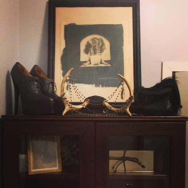 The top of my new cabinet with @workhardened print, #vintagehat from the 30's, #antler neckpiece by #reneemasoomian, and #handmadeshoes. #organizing #decorating