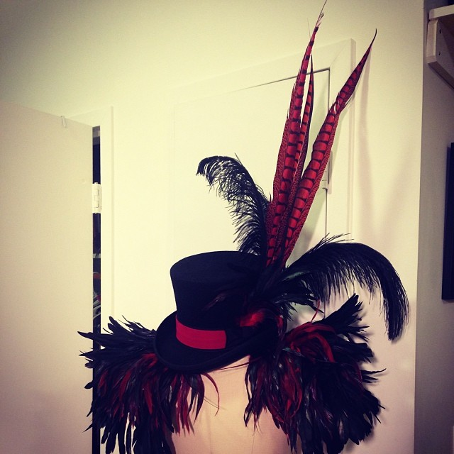 This is what came of all of the feathers. #blackandred #feathers #tophat #costume