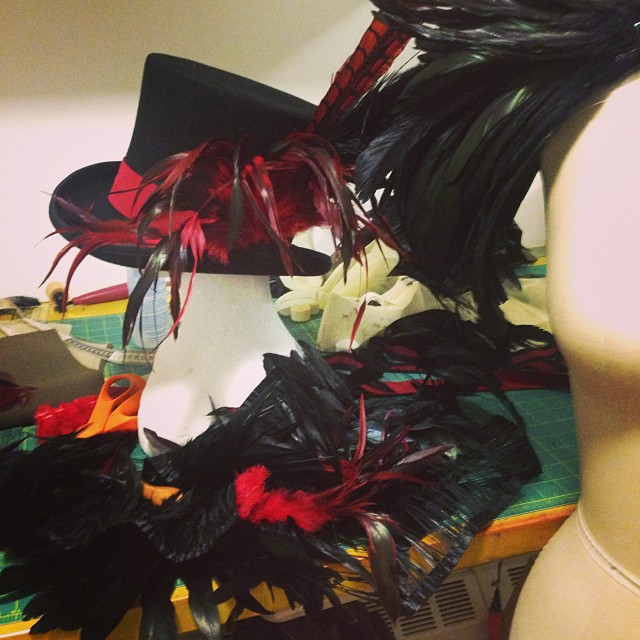 My work table looks like a feather explosion happened. #toomuchwork #feathers #blackandred #hat #costume