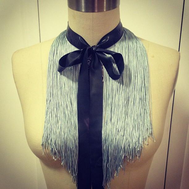 Working on some fun new stuff with #latex and #fringe. #babyloveslatex #latexfashion #fashionlatex #nycfashion #neckpiece