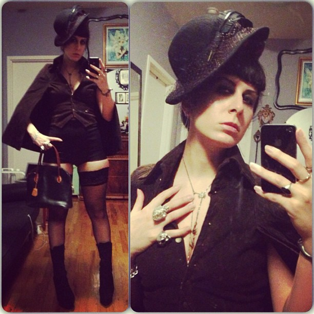 I feel like I need a vintage pipe for this outfit. #lederer #vintagepurse, #leather #hotpants by #reneemasoomian, #nicolemiller cape, #vintagehat, #bloodmilk necklace, #mcqueen #skullring