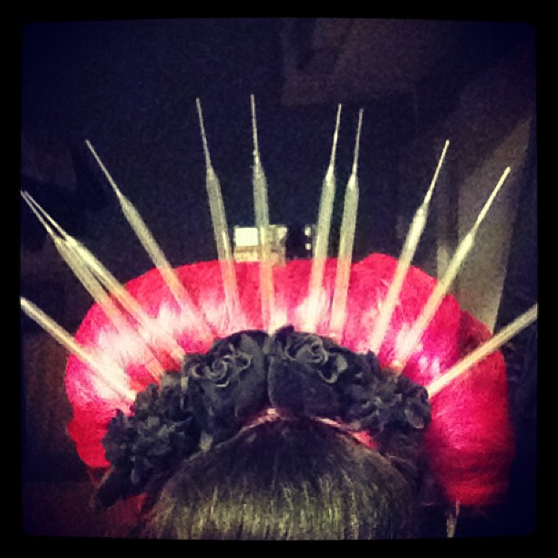 Glass pipette headdress.