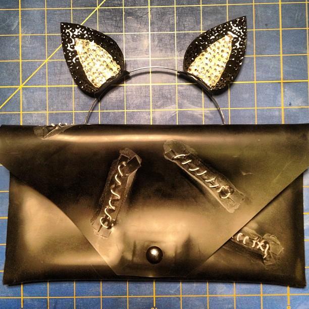 Custom latex Catwoman ears and clutch.