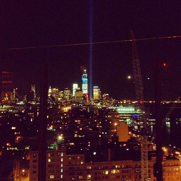 Roof top party with tribute lights in the distance.  (Taken with  Instagram )