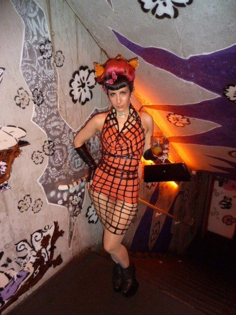 Renee in our BabyLove's Latex net latex cowl top and pencil skirt.