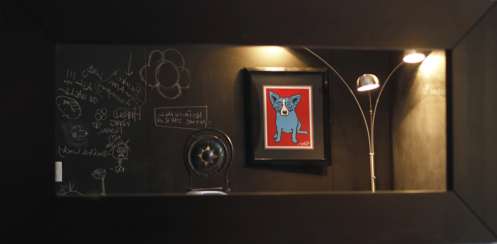 On the wall hanging the world reknowed Blue Dog by George Rodriguez , Photo by Edward Aninaru