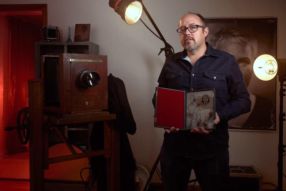 Patrick Andrade inside RELIC studios with his camera and a cased tintype.
