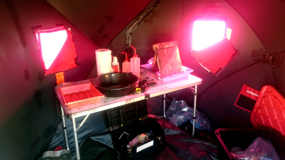 It looks like a cathedral Inside the darkroom (tent). The silver bath (composed of pure silver nitrate and distilled water) on the right, along with water for washing and the fixer tray.