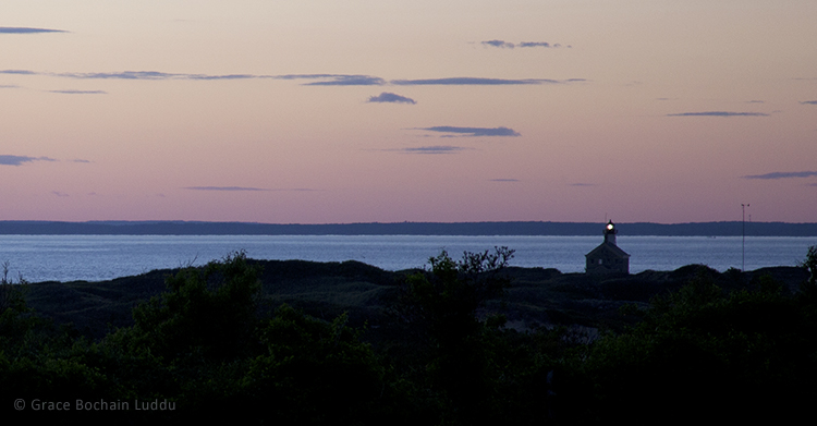 As the sun set the water turned that luminous blue.  This is North Light and off on the horizon is the mainland.