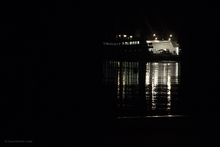 The Block Island Ferry, turned around and backing up to get to the dock on Block Island. See the deck hand, waiting in back, and the line of light defining the shoreline?
