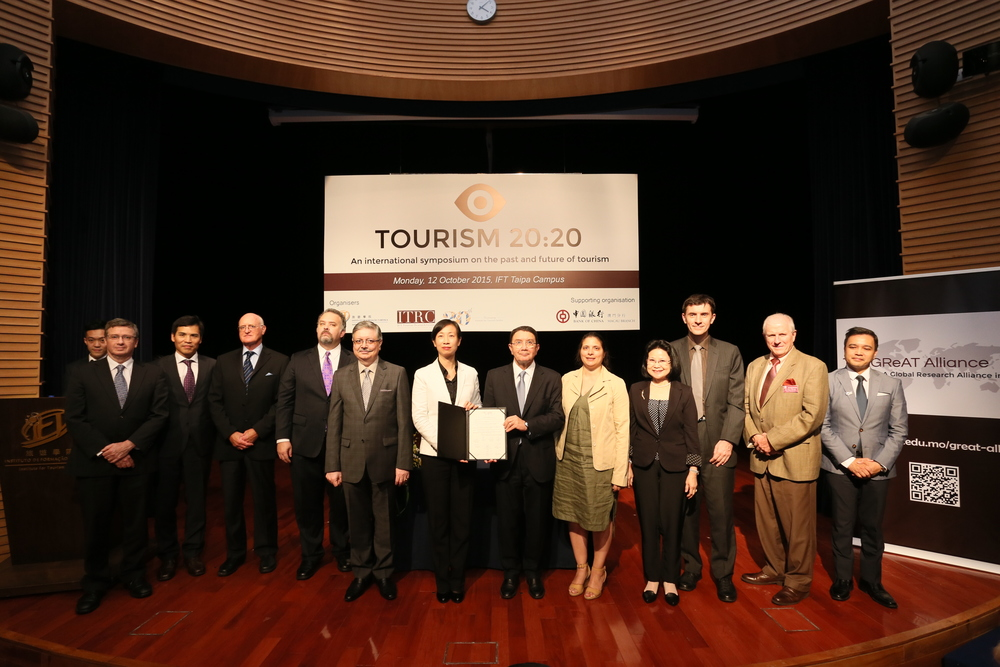 The Honorable Dr. Taleb Rifai, Secretary General of UNWTO and Dr. Fanny Vong, President of IFT, hold up the Joint Statement of the GReAT Alliance after the signing ceremony. Held during the Tourism 20:20 International Symposium on the Past and Future of Tourism at IFT's Taipa Campus, Monday, 12 October 2015.